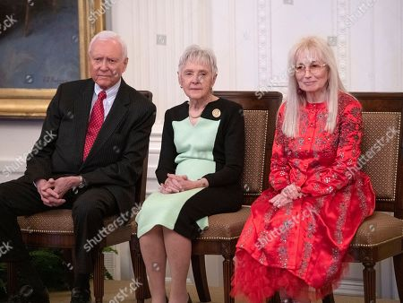 From left to right: United States Senator Orrin Hatch (Republican of Utah), Maureen Scalia, and Miriam Adelson listen prior to receiving the Presidential Medal of Freedom from President Trump during a ceremony in the East Room of the White House in Washington, DC. The award is the nation's highest civilian honor and is awarded by the President to individuals who made meritorious contributions to the United States.