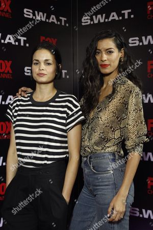 Stephanie Sigman (R) and US actress/cast member Lina Esco pose during the presentation of the new season of the US TV series 'S.W.A.T.', in Mexico City, Mexico, 17 November 2018.