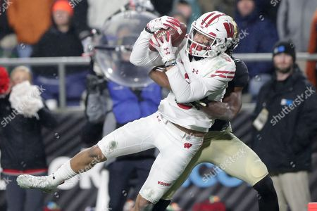 Antonio Blackmon, Danny Davis III. Wisconsin wide receiver Danny Davis III (6) makes a catch for a touchdown in front of Purdue cornerback Antonio Blackmon (14) during the second half of an NCAA college football game in West Lafayette, Ind., . Wisconsin defeated Purdue 47-44 in overtime