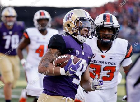 Myles Gaskin, Jalen Moore. Washington's Myles Gaskin (9) rushes as Oregon State's Jalen Moore (33) pursues in the first half of an NCAA college football game, in Seattle