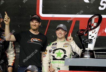 Tyler Reddick, right, poses with Dale Earnhardt Jr., co-owner of JR Motorsports, left, after winning the NASCAR Xfinity Series championship auto race at the Homestead-Miami Speedway, in Homestead, Fla