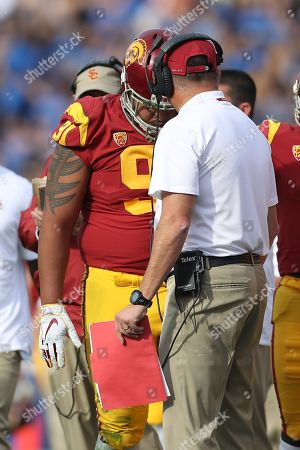 USC Trojans head coach Clay Helton chews out USC Trojans defensive lineman Brandon Pili (91) after Pili extended a drive with a personal foul resulting in a UCLA touchdown during the game versus the USC Trojans and the UCLA Bruins at The Rose Bowl in Pasadena, CA. (Photo by Peter Joneleit)