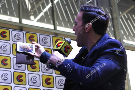 Jason David Frank takes a picture in a forum during the second day of the Comic Con in Medellin, Colombia, 17 November 2018. Frank is known as 'Tommy Oliver', the Green Ranger in the series Power Rangers.
