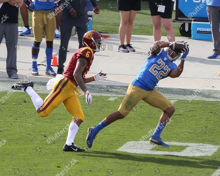Pasadena CA,..UCLA Bruins defensive back Nate Meadors #22 catches an interception during the USC Trojans vs UCLA Bruins at the Rose Bowl in Pasadena, Ca. on , (Photo by Jevone Moore)