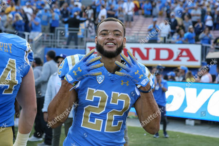 Pasadena CA,..UCLA Bruins defensive back Nate Meadors #22 fours up after the USC Trojans vs UCLA Bruins at the Rose Bowl in Pasadena, Ca. on , (Photo by Jevone Moore)