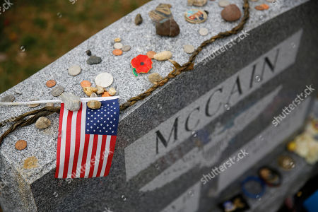 An American flag rests atop a headstone at the gravesite of Sen. John McCain, R-Ariz., at the U.S. Naval Academy Cemetery in Annapolis, Md. McCain died Aug. 25 from brain cancer at age 81