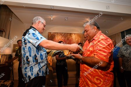 Australia's Prime Minister Scott Morrison (L) gives Narau's President Baron Waqa a Wallabies jersey at a barbeque for Pacific Islands leaders at the Australian High Commission after the 2018 Asia-Pacific Economic Cooperation (APEC) forum in Port Moresby, Papua New Guinea, 18 November 2018.