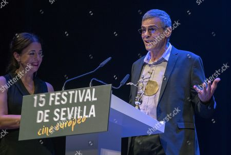 Abdellatif Kechiche (R) delivers a speech after he received Giraldillo of Honor Award during the closing ceremony of 15th Seville European Film Festival in Seville, southern Spain, 17 November 2018.