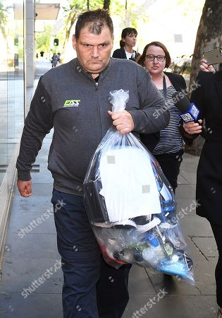 Stock Photo of Michael Rogers is seen leaving Melbourne Magistrates Court, in Melbourne, Victoria, Australia, 17 November 2018 (issued 18 November 2018). Michael Rogers, 46, now known as 'Trolley Man' after he rammed the Bourke Street attacker with a trolley last week, has been granted bail on burglary and theft offences.