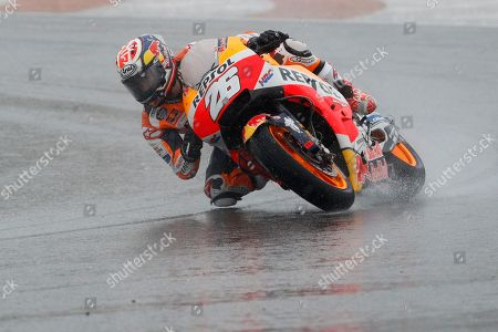 Stock Image of MotoGP Honda rider Dani Pedrosa of Spain rides during the Motorcycle Grand Prix at the Ricardo Tormo circuit in Cheste near Valencia, Spain