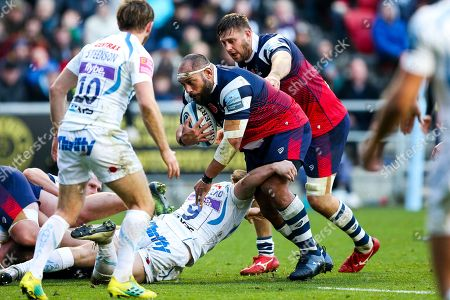 John Afoa of Bristol Bears is tackled by Stuart Townsend of Exeter Chiefs