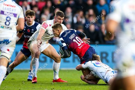 Callum Sheedy (co-capt) of Bristol Bears is tackled by Stuart Townsend of Exeter Chiefs