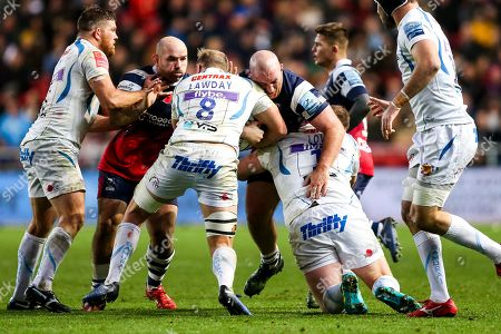 Stock Photo of Yann Thomas of Bristol Bears is tackled by Tom Lawday and Moray Low of Exeter Chiefs