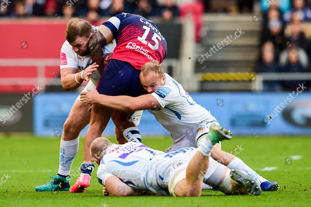 Charles Piutau of Bristol Bears is tackled by Moray Low of Exeter Chiefs and Tom Lawday of Exeter Chiefs
