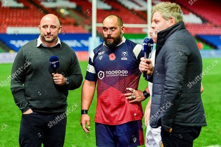 John Afoa of Bristol Bears and Gareth Steenson of Exeter Chiefs join David Flatman after the final whistle of the match