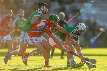 Liam Mellows vs St. Thomas. Liam Mellows' Mark Hughes and Jack Hastings with David Burke of St. Thomas