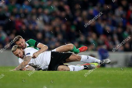 Gareth McAuley of Northern Ireland tackles Marko Arnautovic of Austria