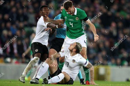 David Alaba of Austria intervenes as tempers start to flare between Gareth McAuley of Northern Ireland and Marko Arnautovic of Austria