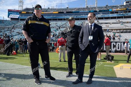 Jacksonville Jaguars head coach Doug Marrone, left, executive vice president of football operations Tom Coughlin, center, and general manager David Caldwell watch warmups before an NFL football game against Pittsburgh Steelers, in Jacksonville, Fla