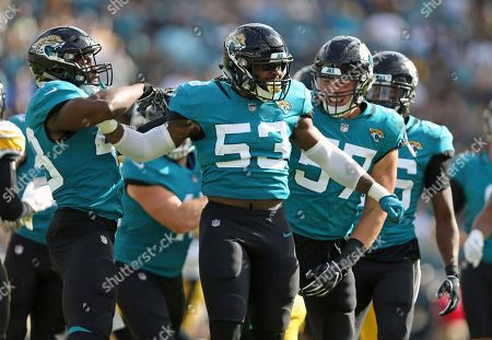 Jacksonville Jaguars linebacker Blair Brown (53) celebrates a big play against the Pittsburgh Steelers with teammates including linebacker Nick DeLuca (57) during the first half of an NFL football game, in Jacksonville, Fla