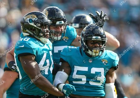 Jacksonville Jaguars outside linebacker Leon Jacobs (48), linebacker Nick DeLuca (57) and linebacker Blair Brown (53) celebrate a defensive stand during the first half of an NFL football game against the Pittsburgh Steelers, in Jacksonville, Fla