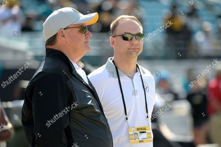 Stock Picture of Pittsburgh Steelers general manager Kevin Colbert, left, talks with minority owner Thomas Tull during warmups before an NFL football game against the Jacksonville Jaguars, in Jacksonville, Fla