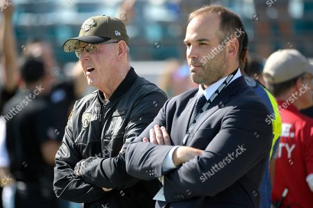 Jacksonville Jaguars general manager David Caldwell, right, and executive vice president of football operations Tom Coughlin watch warmups before an NFL football game against the Pittsburgh Steelers, in Jacksonville, Fla