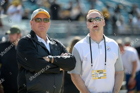 Stock Photo of Pittsburgh Steelers general manager Kevin Colbert, left, and minority owner Thomas Tull watch warmups before an NFL football game against the Jacksonville Jaguars, in Jacksonville, Fla