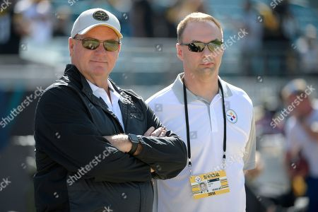 Pittsburgh Steelers general manager Kevin Colbert, left, and minority owner Thomas Tull watch warmups before an NFL football game against the Jacksonville Jaguars, in Jacksonville, Fla