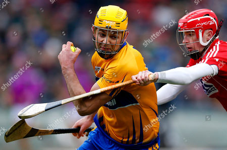 Stock Image of Clare Right corner back Patrick O'Connor (L) gets around Cork Substitute Killian Burke (R) in the semifinal game of the Fenway Hurling Classic held at Fenway Park in Boston, Massachusetts, USA 18 November 2018. The modified version of the amateur sport of Hurling to the Super 11s format is to allow the game to be played on smaller fields.