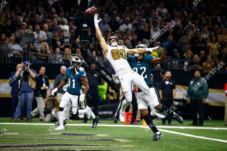 Stock Image of New Orleans Saints wide receiver Austin Carr (80) leaps for a pass in the end zone as Philadelphia Eagles cornerback Rasul Douglas (32) covers in the first half of an NFL football game in New Orleans