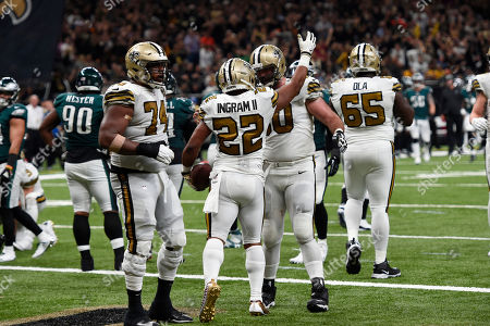 New Orleans Saints running back Mark Ingram (22) celebrates his touchdown with center Max Unger and offensive guard Jermon Bushrod (74) in the second half of an NFL football game in New Orleans