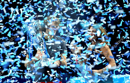 Alexander Zverev of Germany celebrates with the trophy and Annabel Croft through the confetti