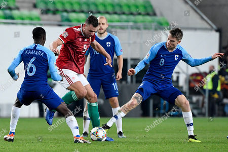 Stock Picture of Robert Taylor (L) and Glen Kamara (R) of Finland challenge Adam Szalai of Hungary for the ball during the soccer UEFA Nations League match Hungary vs. Finland in Budapest, Hungary, 18 November 2018.