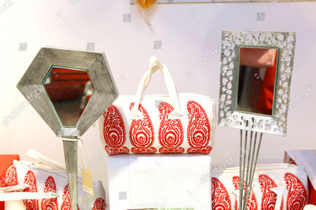 Items for sale at Priscilla Carluccio's shop 'Few and Far'. From left, Cubist hand mirror, £395, Indian bag £39, KYC hand mirror £295.