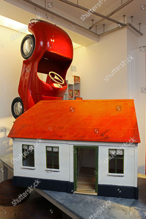 A 1950's Austin Pedal Car (£3500) and a dolls house hand built in Transylvania (£895).