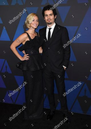 Damien Chazelle, Olivia Hamilton. Damien Chazelle, right, and Olivia Hamilton arrive at the Governors Awards, at the Dolby Theatre in Los Angeles