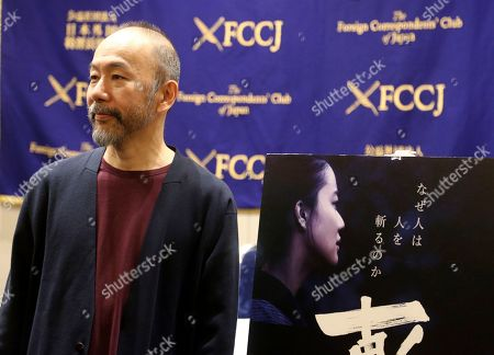 "Japanese director Shinya Tsukamoto speaks to reporters about his latest film ""Killing"" during a press conference in Tokyo. He said he turned to the Japanese masters for inspiration but also emulated the way Martin Scorsese gave free rein to his actors, a technique he learned when he was cast in ""Silence,"" to play a Christian martyr. ""Killing,"" a poetic but brutal story about the horrors of violence, premiered at the Venice Film Festival earlier this year and opens in Japan on Nov. 24"