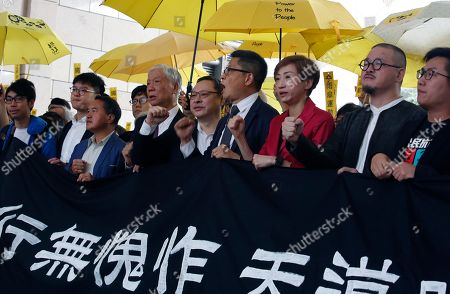 Occupy Central activists (L-R) Eason Chung Yiu-wah, Tommy Cheung Sau-yin, former Democratic Party lawmaker Lee Wing-tat, Reverend Chu Yiu-ming, Benny Tai, Dr. Chan Kin-man, Civic Party lawmaker Tanya Chan, Shiu Ka-chun, and League of Social Democrats vice-chairman Raphael Wong Ho-ming, prepare to enter court on public nuisance charges in Hong Kong, China, 19 November 2018. The Umbrella movement, which ran concurrently with Occupy Central, ran for 79 days in 2014, but failed to bring about genuine universal suffrage in Hong Kong, as was its mission.