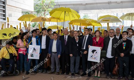 Occupy Central activists (L-R) Eason Chung Yiu-wah (first row blue jacket), Tommy Cheung Sau-yin, former Democratic Party lawmaker Lee Wing-tat, Reverend Chu Yiu-ming, Benny Tai, Dr. Chan Kin-man, Civic Party lawmaker Tanya Chan, Shiu Ka-chun, League of Social Democrats vice-chairman Raphael Wong Ho-ming prepare to enter court on public nuisance charges in Hong Kong, China, 19 November 2018. The Umbrella movement, which ran concurrently with Occupy Central, ran for 79 days in 2014, but failed to bring about genuine universal suffrage in Hong Kong, as was its mission.