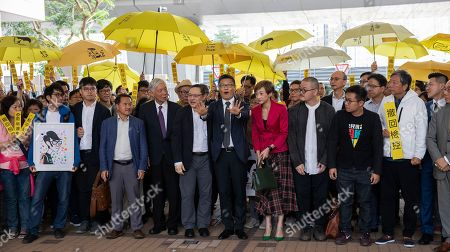 Occupy Central activists (L-R) Eason Chung Yiu-wah (first row blue jacket), Tommy Cheung Sau-yin, former Democratic Party lawmaker Lee Wing-tat, Reverend Chu Yiu-ming, Benny Tai, Dr Chan Kin-man, Civic Party lawmaker Tanya Chan, Shiu Ka-chun, and League of Social Democrats vice-chairman Raphael Wong Ho-ming prepare to enter court on public nuisance charges, Hong Kong, China, 19 November 2018. The Umbrella movement, which ran concurrently with Occupy Central, ran for 79 days in 2014, but failed to bring about genuine universal suffrage in Hong Kong, as was its mission.