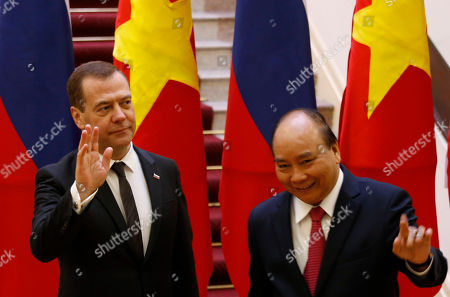Russia's Prime Minister Dmitri Medvedev (L) poses for a photo with his Vietnamese counterpart Nguyen Xuan Phuc (R) at the Government Office in Hanoi, Vietnam, 19 Novemeber 2018.
