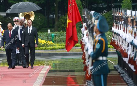 Russia's Prime Minister Dmitri Medvedev (2-L) reviews the guard of honour during a welcoming ceremony with his Vietnamese counterpart Nguyen Xuan Phuc (L) at the Presidential Palace in Hanoi, Vietnam, 19 Novemeber 2018.