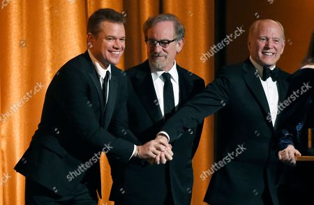 Matt Damon, Steven Spielberg, Frank Marshall. Actor Matt Damon, left, congratulates producer Frank Marshall, right, onstage after he and his wife Kathleen Kennedy were given the Irving G. Thalberg Memorial Award at the 2018 Governors Awards at The Ray Dolby Ballroom, in Los Angeles. Looking on at center is director Steven Spielberg