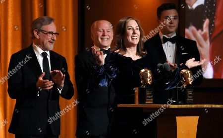 Kathleen Kennedy, Frank Marshall, Steven Spielberg. Producer Kathleen Kennedy addresses the audience after she and her husband Frank Marshall, second from left, were given the Irving G. Thalberg Memorial Award at the 2018 Governors Awards at The Ray Dolby Ballroom, in Los Angeles. Looking on at left is presenter Steven Spielberg