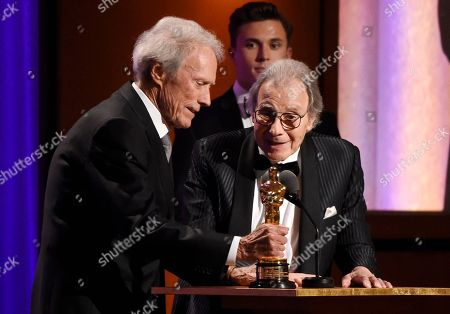 Stock Picture of Lalo Schifrin, Clint Eastwood. Actor-filmmaker Clint Eastwood, left, presents composer Lalo Schifrin with an honorary Oscar onstage at the 2018 Governors Awards at The Ray Dolby Ballroom, in Los Angeles