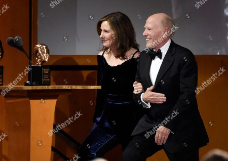 Kathleen Kennedy, Frank Marshall. Producers Kathleen Kennedy, left, and Frank Marshall take the stage to accept the Irving G. Thalberg Memorial Award at the 2018 Governors Awards at The Ray Dolby Ballroom, in Los Angeles