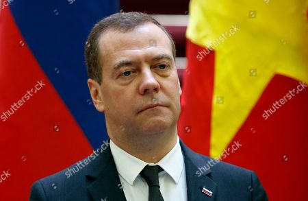 Russia's Prime Minister Dmitri Medvedev attends a press conference with his Vietnamese counterpart Nguyen Xuan Phuc (not pictured) at the Government Office in Hanoi, Vietnam, 19 November 2018.