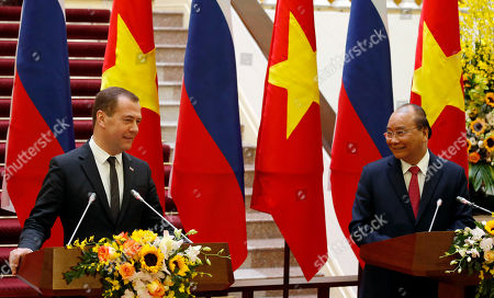 Russia's Prime Minister Dmitri Medvedev (L) attends a press conference with his Vietnamese counterpart Nguyen Xuan Phuc (R) at the Government Office in Hanoi, Vietnam, 19 November 2018.