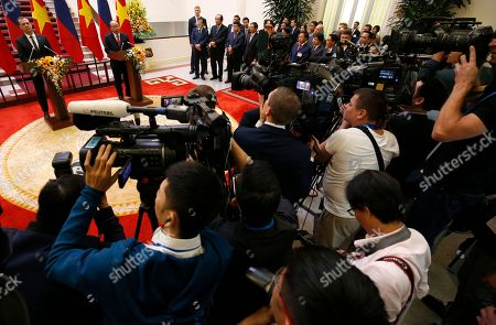 Russia's Prime Minister Dmitri Medvedev attends a press conference with his Vietnamese counterpart Nguyen Xuan Phuc at the Government Office in Hanoi, Vietnam, 19 November 2018.